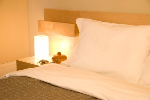 Interior, bed, bedside table, lamp, pillows